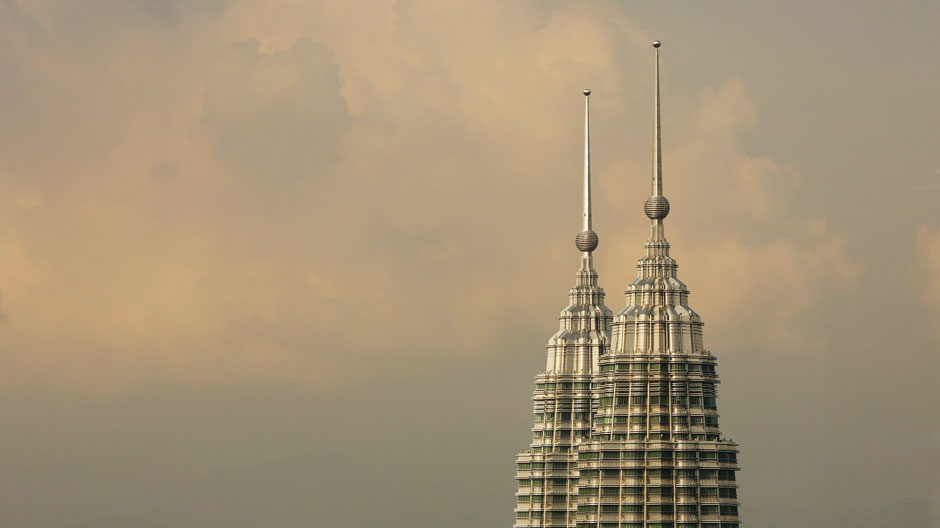 The peaks of the Petronas Twin Towers is seen in central Kuala Lumpur, August 16, 2014.