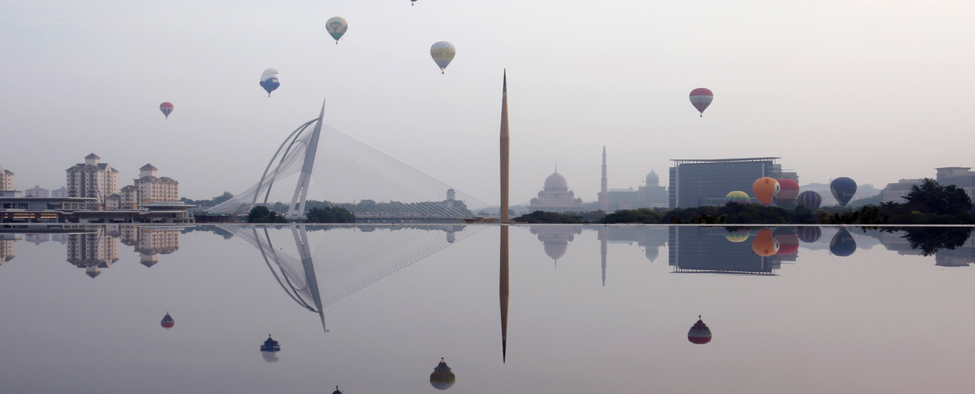 Hot air balloons from the 5th Putrajaya International Hot Air Balloon Fiesta 2013 float over the skies of Malaysia's capital of Putrajaya, outside Kuala Lumpur