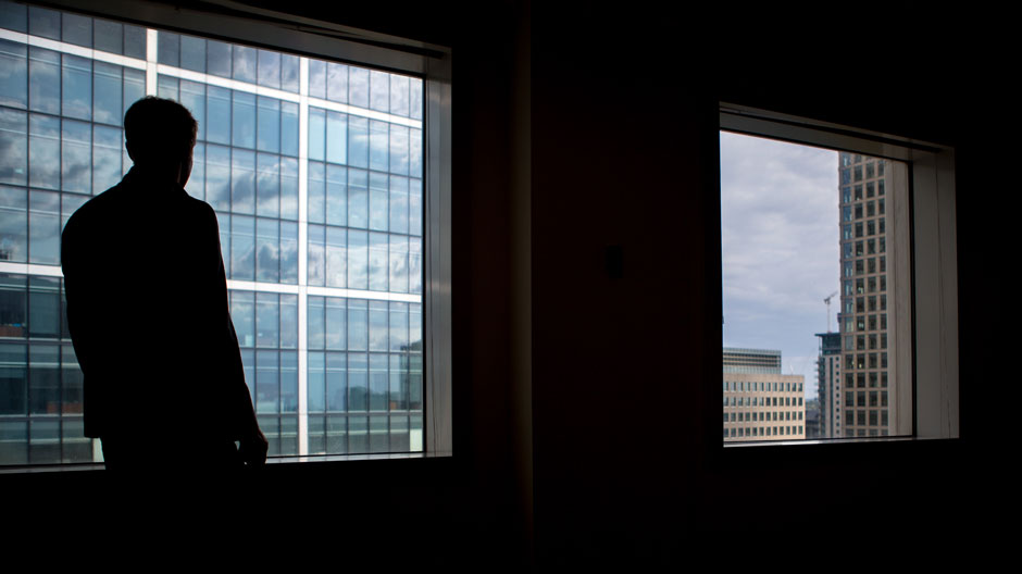 Silhouette of business man at window