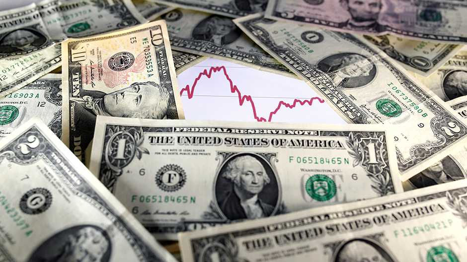 U.S. dollar notes are seen in front of a stock graph in this November 7, 2016 picture illustration. Picture taken November 7.
